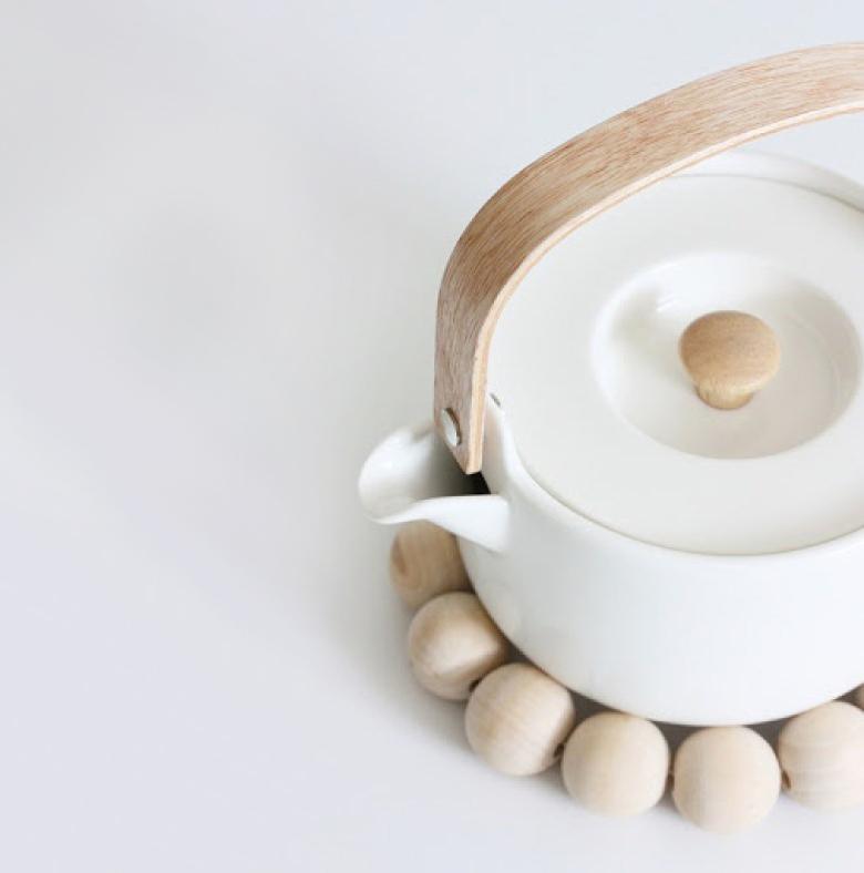 Oiva ceramic teapot with wooden handle by Marimekko