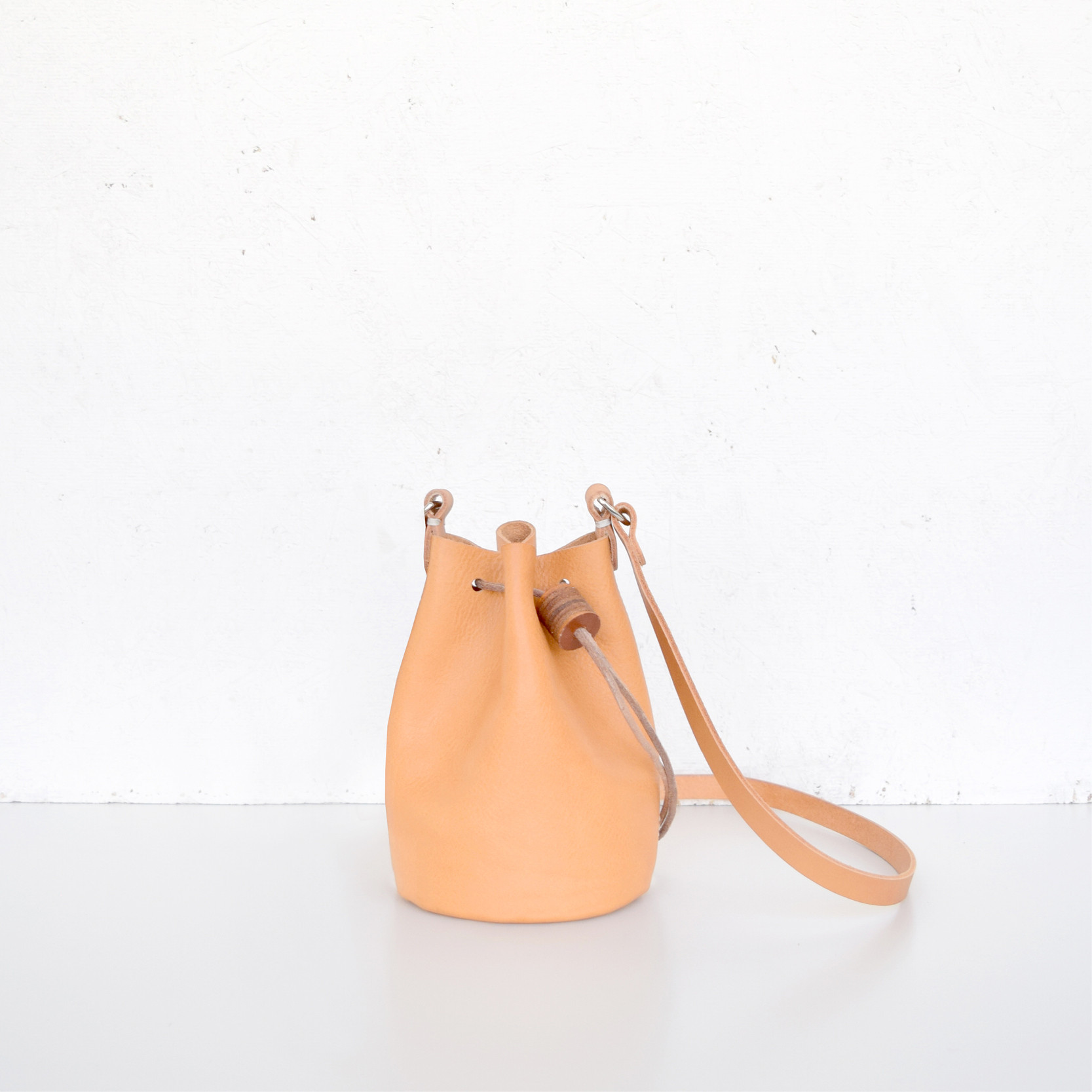 Minimalistic British bucket bag by Alfie Douglas