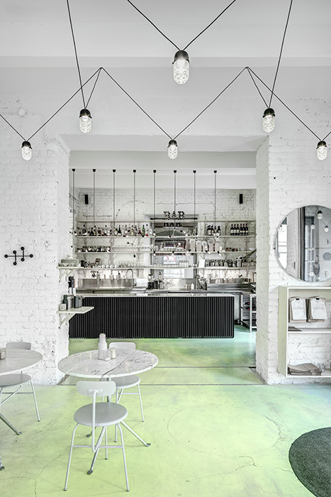 Phill's Corner Bistro Interior Design | mint-green concrete floor