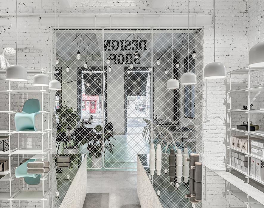 Phill's Corner Bistro Interior Design   mint-green concrete floor & white brick walls