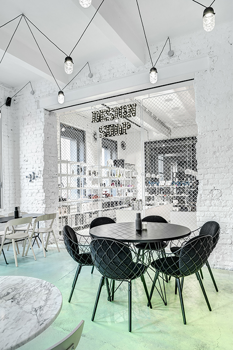 Phill's Corner Bistro Interior Design | mint-green concrete floor & white brick walls