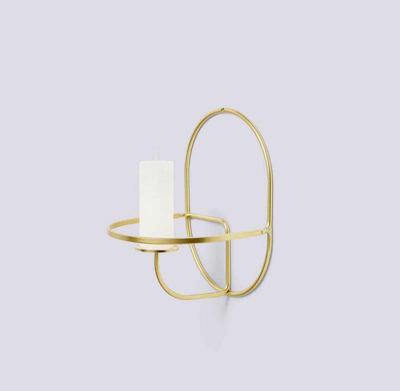 Lup – wall mounted brass candle holder by HAY
