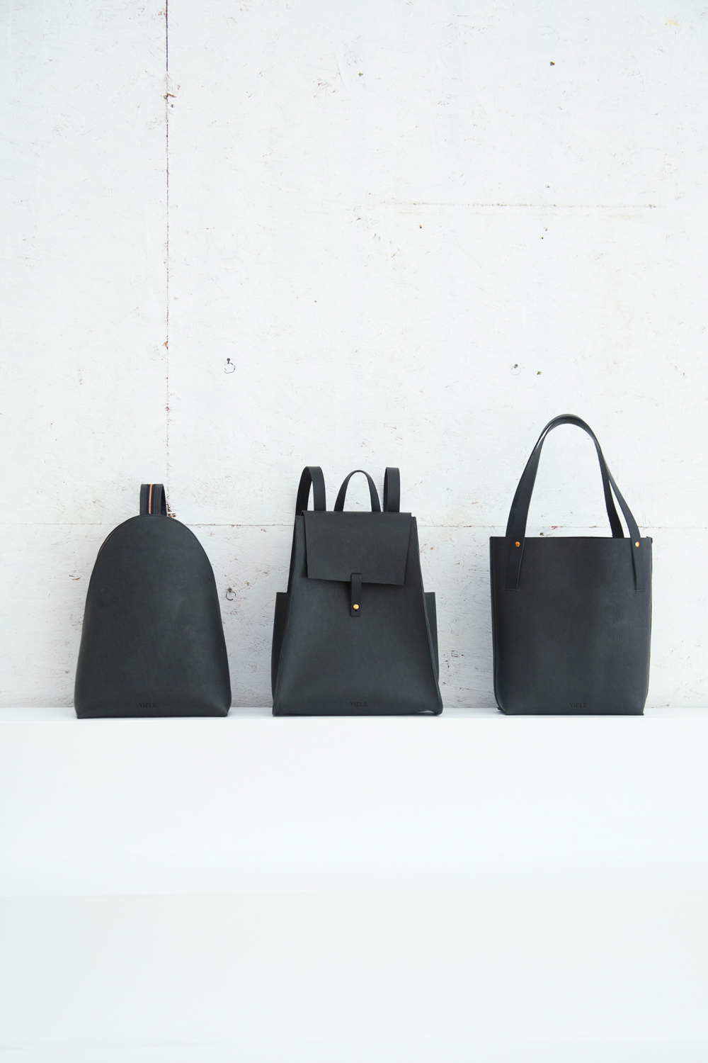 Yield | simple leather backpack and shopper