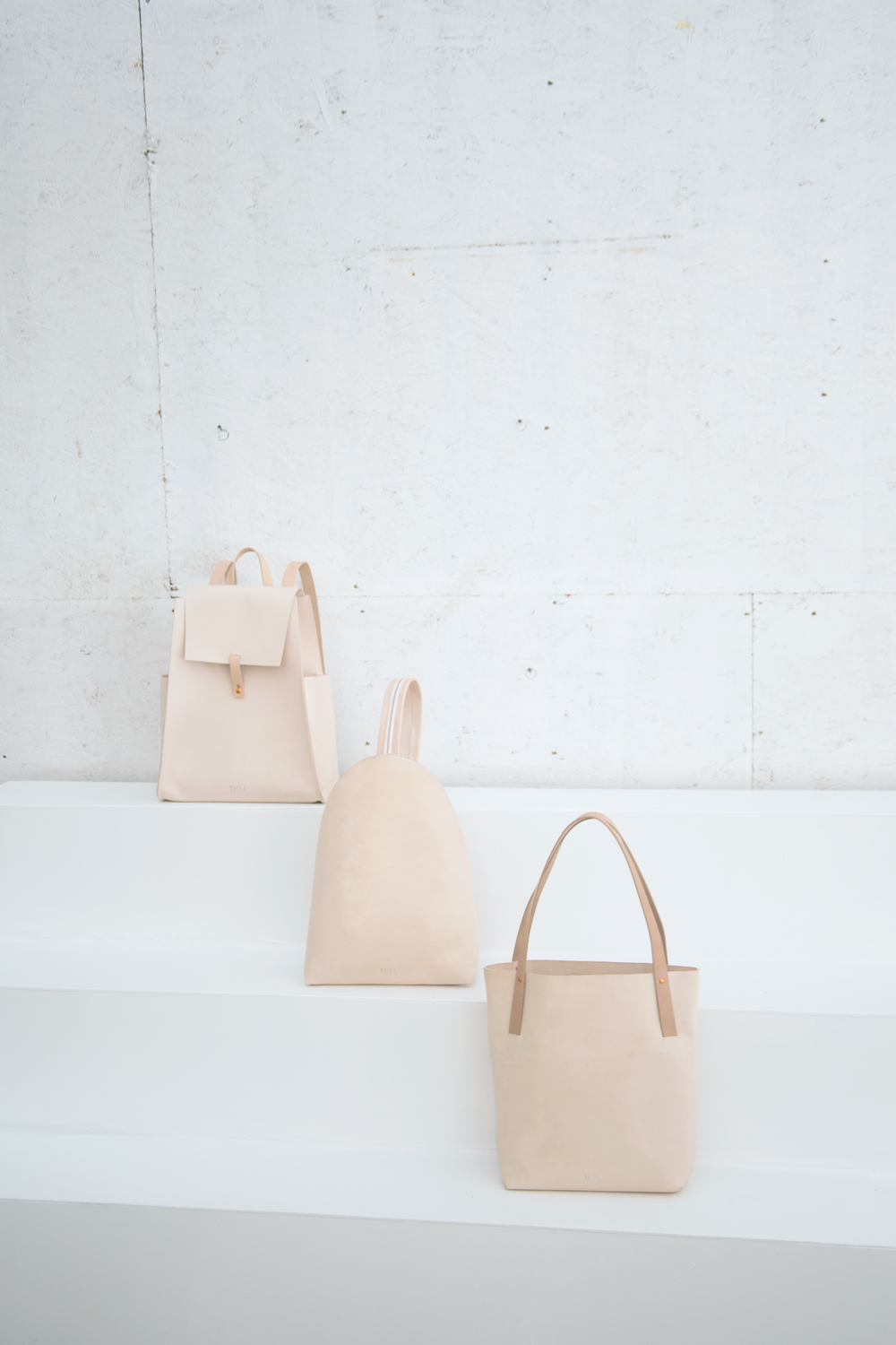 Yield | simple nude leather backpack and shopper