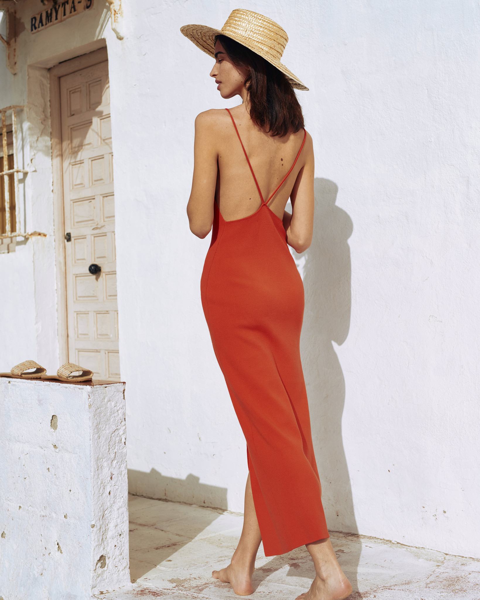 Nanushka | long open-back knit dress
