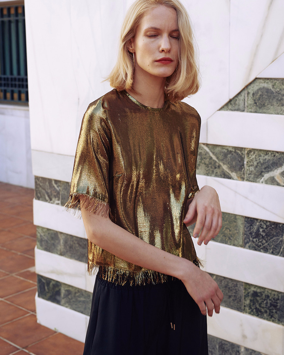 Relaxed fit woven top in a slightly see-through silk mix fabric. #fringes